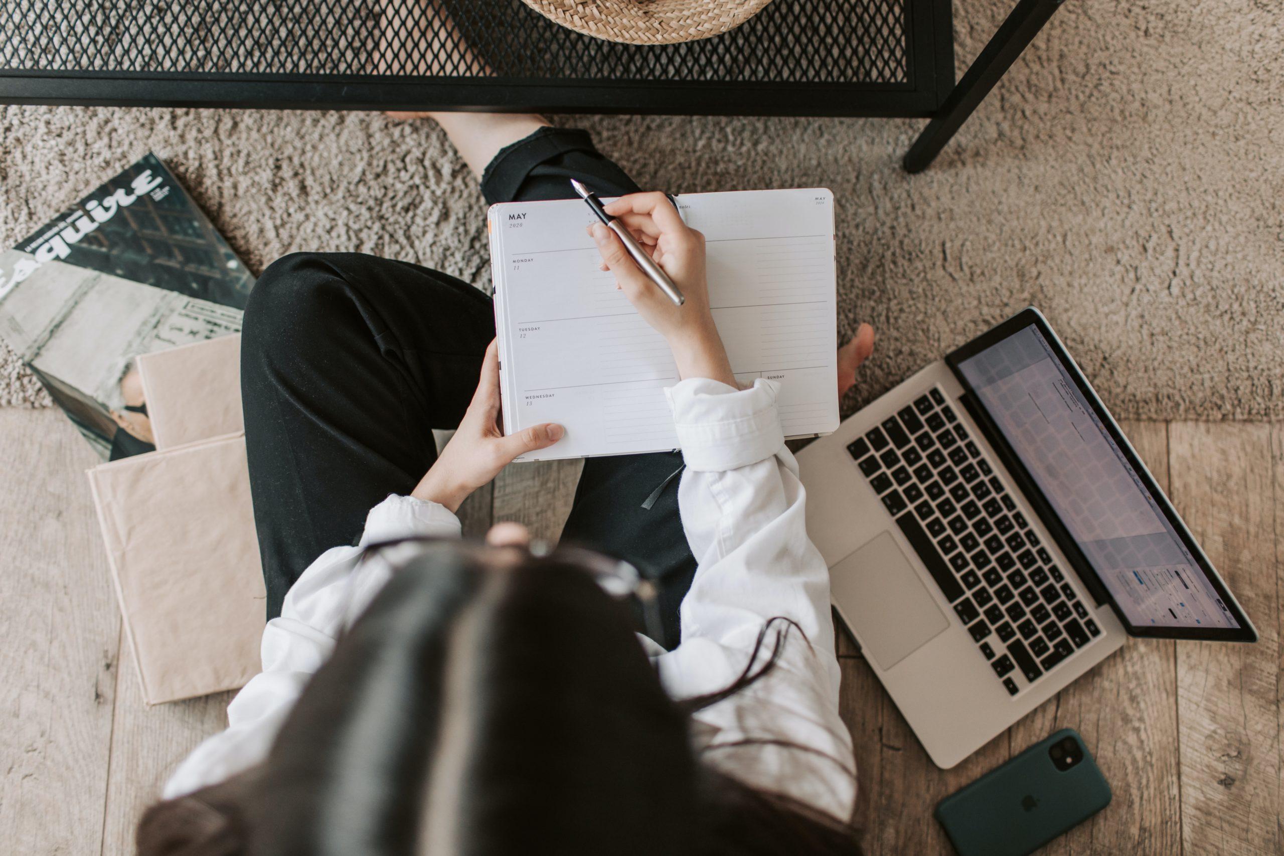 student sitting on floor working on computer